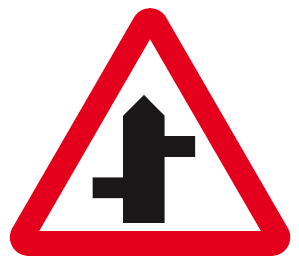 A sign warning of a staggared junction