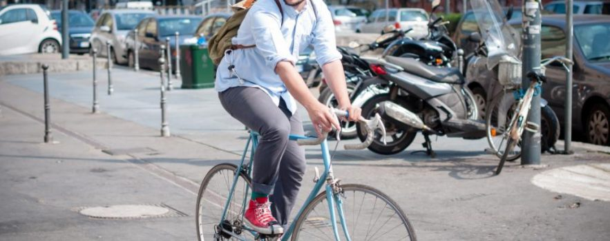 A young man rides a bicycle