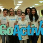 A group of teenagers shouting. The word 'GoActive' is superimposed on the image